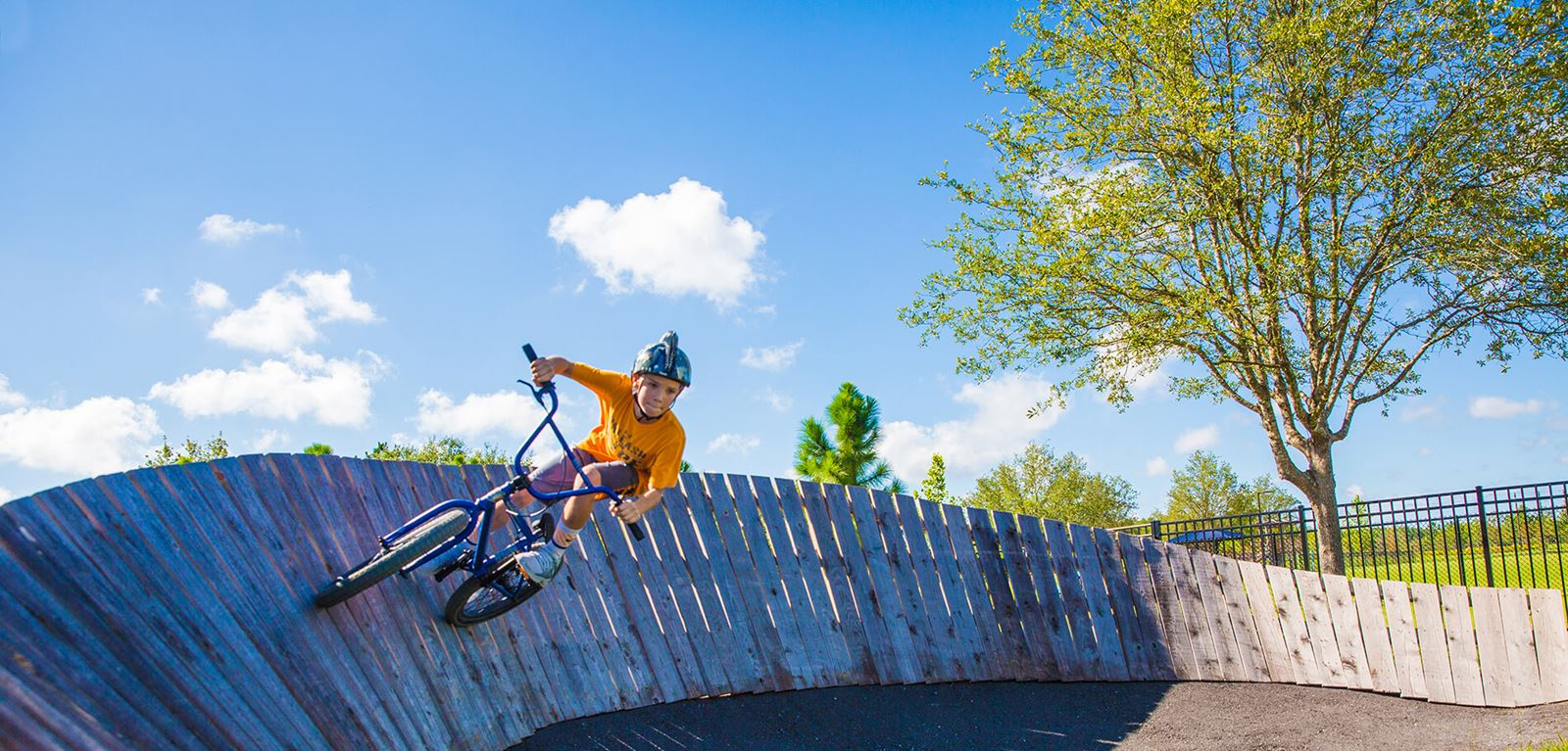 Kid on bike ramp at BMX park in Bexley.