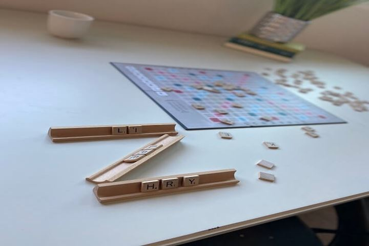 Scrabble board and wooden pieces on a table